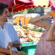 Couple having fun in a market — Stock Photo