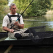 Stock Photo: Senior fishing