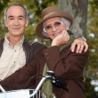 Older couple with a bicycle — Stock Photo