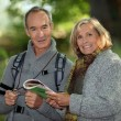 Senior couple going for a walk — Stock Photo