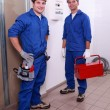 Stock Photo: Men in blue collar