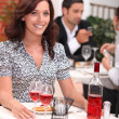 Woman having meal in restaurant — Stock Photo