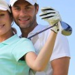 Golfing couple — Stock Photo