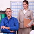 Tradesman in his office with his secretary — Stock Photo #9211340