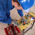 Plumber measuring pipe — Stock Photo #9211474