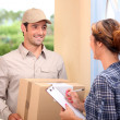 Stock Photo: Courier delivering parcel