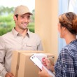 Courier delivering parcel — Stockfoto #9211685