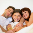 Couple and daughter in bed — Stock Photo