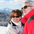 Mature couple on a skiing holiday — Stock Photo