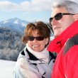 Mature couple on a skiing holiday - Stock Photo