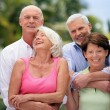 Two senior couples in the garden — Stock Photo
