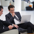 Businessmen waiting in airport lounge — Stock Photo