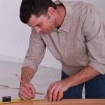 Handyman with lead pencil — Stock Photo
