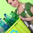 Young woman taking out the recycling - 图库照片