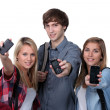Stock Photo: Teenagers showing mobile phones