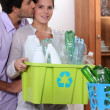 Stock Photo: Couple taking out recycling