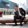 Businessman on a call in the city — Stock Photo