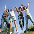 Happy teenagers jumping in air — Stock Photo #9213878