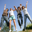 Happy teenagers jumping in air — Stock Photo