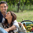 Couple drinking wine in vineyard — Stock Photo