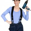 Woman holding up an electric screwdriver — Stock Photo