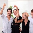 Stock Photo: Two young couples drinking champagne