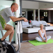 Stock Photo: Elderly couple working out at home