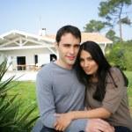 Couple sat on garden decking — Stock Photo