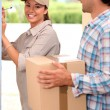 Stock Photo: Pretty delivery girl doing her job