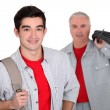 An apprentice standing near his boss — Stock Photo