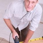 Man using a jigsaw — Stock Photo #9215205