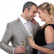 Couple drinking champagne in studio — Stock Photo
