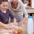 Mother baking with her daughter — Stock Photo #9215607