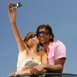 Couple taking a self-portrait with a cameraphone — Stock Photo #9216724