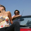 Couple with convertible car — Stock Photo #9216941
