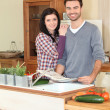 Smiling woman and man in kitchen — Stock Photo