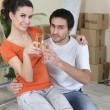 Young woman and man new home — Stock Photo