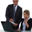 Boss handing note to young assistant — Stock Photo