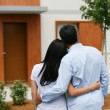 Couple looking at their new home — Stock Photo #9218598