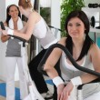 Women using gym equipment — Stock Photo