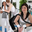 Stock Photo: Women using gym equipment