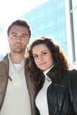 Couple stood outside modern office block — Stock Photo