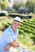 Senior visiting a vineyard — Stock Photo