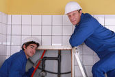 Portrait of two plumbers — Stock Photo