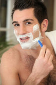 Man shaving his face — Stock Photo