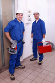 Men in blue collar — Stock Photo