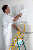 Man painting a wall — Stock Photo