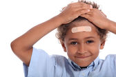 Little boy with plaster on head — Stock Photo