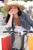 Woman shopping on bike — Stock Photo