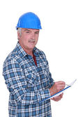 Construction foreman evaluating an employee — Stock Photo